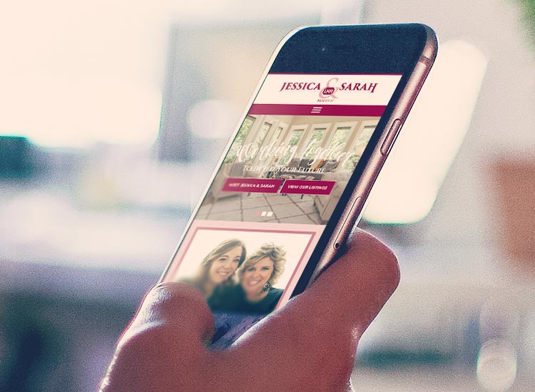 The Jessica and Sarah website appears on a mobile phone