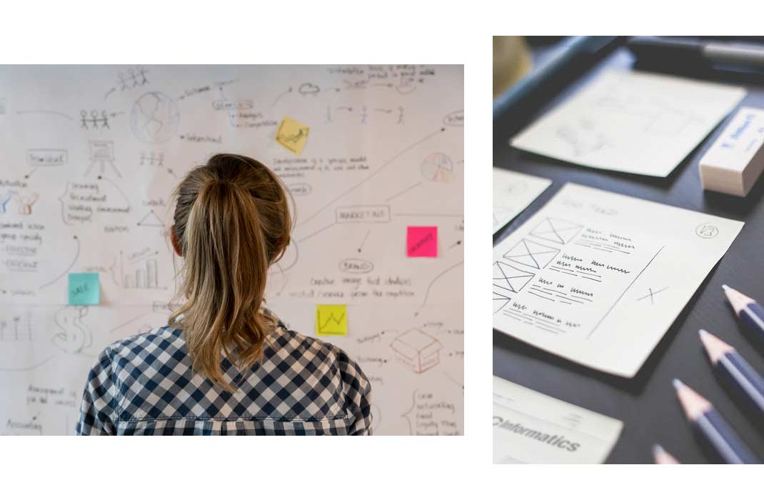 A designer looks at a wall full of post-its and planned user flows